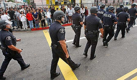 L.A. police march on a local high school to put down fighting between Mexicans and black American students. Other violent confrontations have envolved white and Mexican students. The last riot occurred earlier this year in L.A. The words that describe Mexicans, legal and illegal, are 'filled with HATE. Hate for America and white Americans.