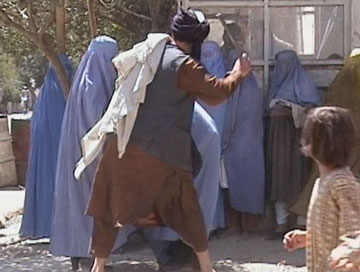Taliban religious police beating Afghan woman for some dress code infraction while a little girl ponders her life as an adult.