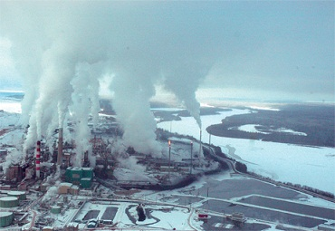 Tar sands oil production pollutes the ground, rivers, and atmosphere.