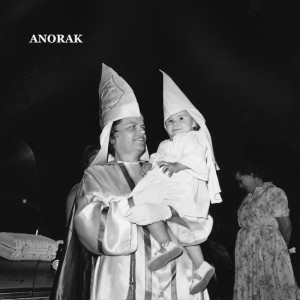 A member of the Ladies' Auxiliary of the United Klans of America, Inc., holds her young daughter, also robed in a Klan suit, at a Ku Klux Klan rally in Atlanta, Ga. on June 5, 1965. Some 600 persons attended the rally. The woman did not want to be indentified. (AP Photo)